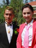 张柏芝红装参加弟弟婚礼 携两个儿子喜庆亮相