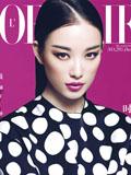 倪妮《时装》杂志封面大片 精致五官中性帅气